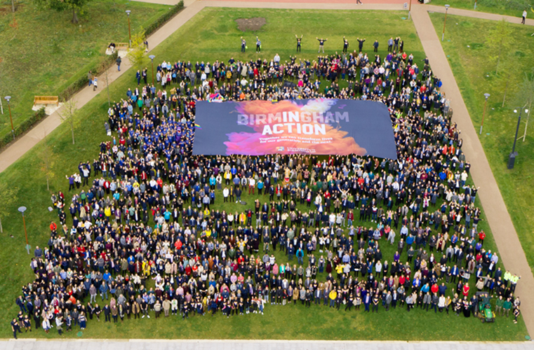 Aerial photo of large group of people in University of Birmingham's Green Heart