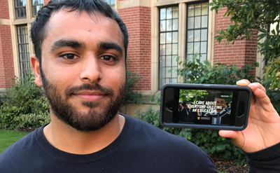 Student holding up smartphone to camera
