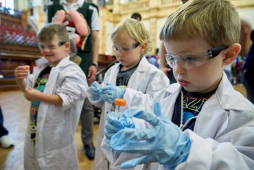 Future Scientists in labcoats and goggles