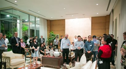 Large group of Singapore alumni listening to a speaker