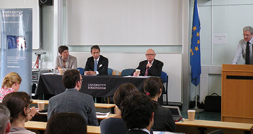 Photo of Professor Trybus and a panel of speakers at the IEL conference 2012