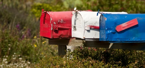Photograph of US mailboxes in red, white and blue