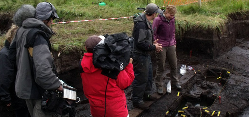 Photograph of a film crew at an archaeological dig