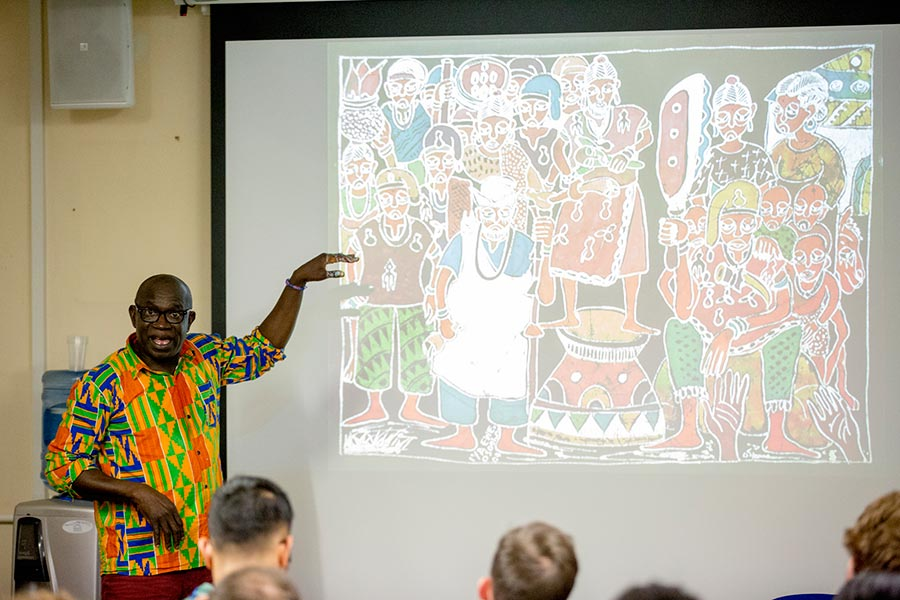 Lekan Babalola describing an exhibition