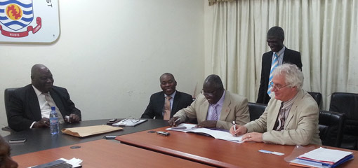 Michael Whitby signing a Memorandum of Understanding between the University of Cape Coast and the University of Birmingham