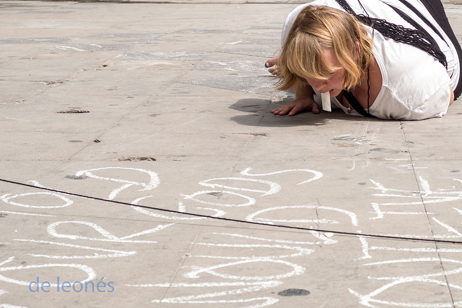 Writing in chalk on the floor