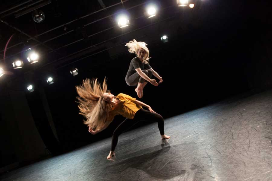 Libby Fox and Louisa Robey performing at De Montfort University during their BA Dance Course; photo by Olga Galona