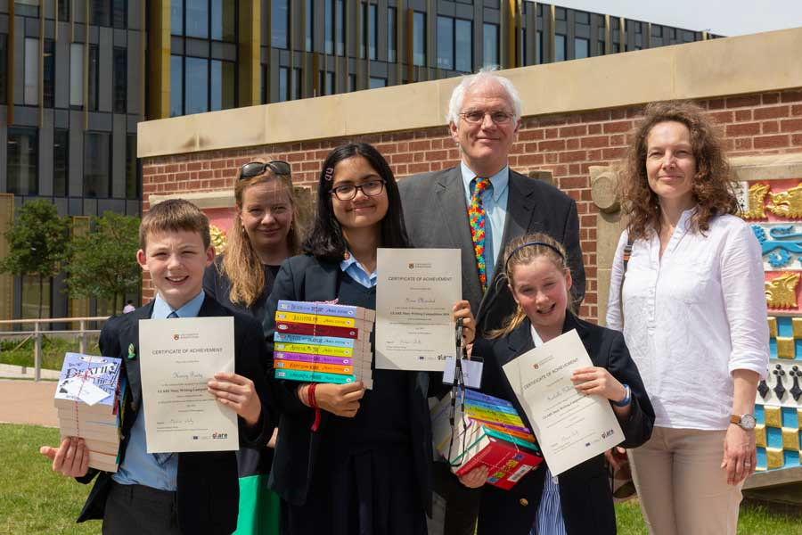 Winners of the GLARE creative writing competition with Pro Vice Chancellor Professor Michael Whitby, Professor Michaela Mahlberg, and Anna Cermakova