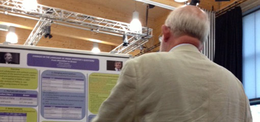 Charles Clarke reading a poster