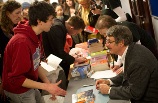 Photograph of writer David Lodge at a book signing with students