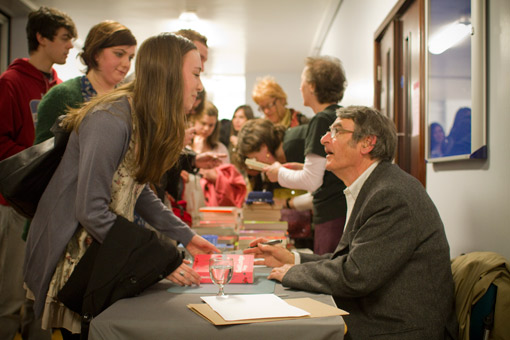 Photograph of David Lodge signing books following his Birmingham Visiting Writers' Programme lecture