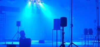 Speakers set up under blue lighting