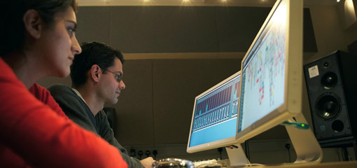 Photograph of two students working with music software on computers