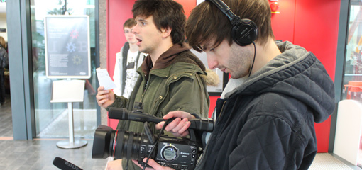 Photograph of two postgraduate students with cameras