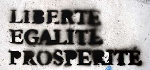 Photograph of graffiti declaring liberte egalite prosperite