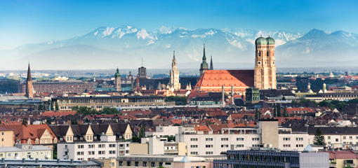 Photograph of Munich with mountains in the background