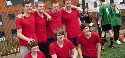 Photograph of a football team in red shirts