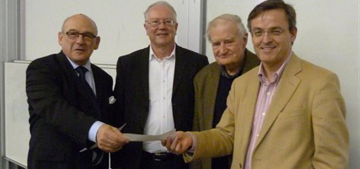 Howard Rosen presenting the Max Rosen Essay Prize to Brian Curragh at the Spring Day School on 2 March, with Dr John Bourne and Professor Peter Simkins, President of the Western Front Association, looking on.