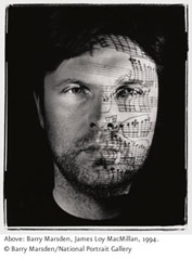 Photograph of a man with a musical score projected on his face