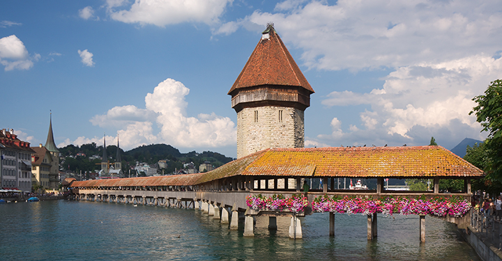 Photo of the Kapellbrücke, a covered wooden footbridge spanning diagonally across the Reuss River in the city of Lucerne in central Switzerland