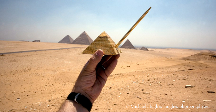 Photo by Michael Hughes of the pyramids and a pyramid souvenir