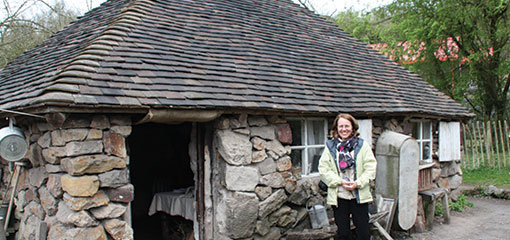 Photograph of Catherine Lavoie outside the Squatters Cottage at Ironbridge