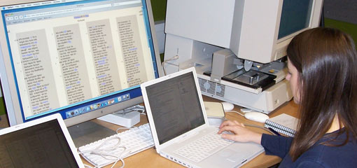 Photograph of a female researcher working on a laptop