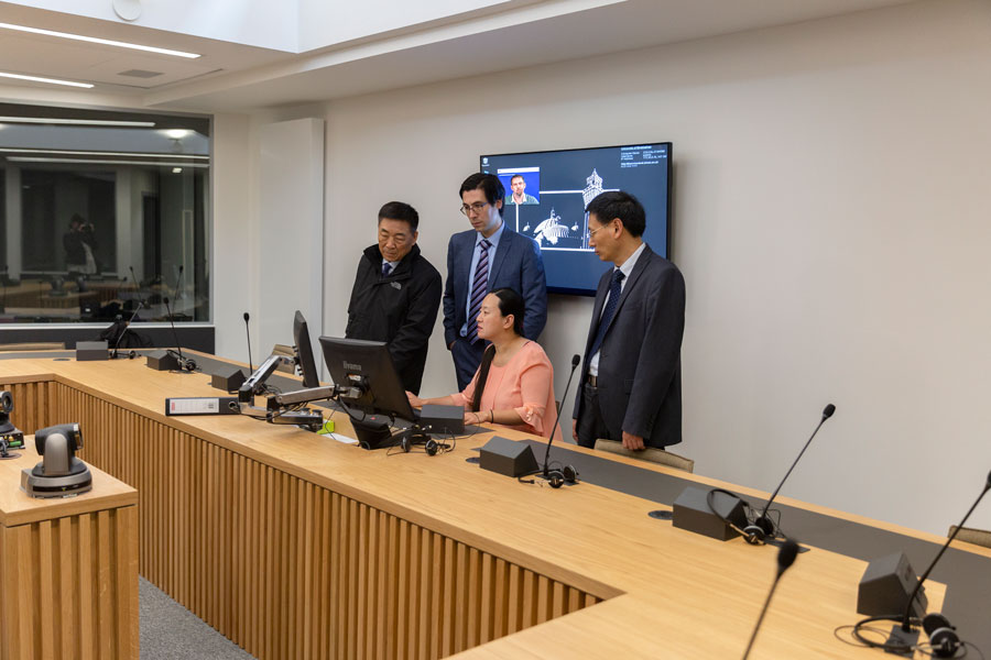 Visit of the Translation and Interpreting Lab, with Dr Xiaohui Yuan, Lecturer in Interpreting and Translation Studies in LCAHM,  explaining its operation to Prof. Wang and Keli and Dr Sèbe.