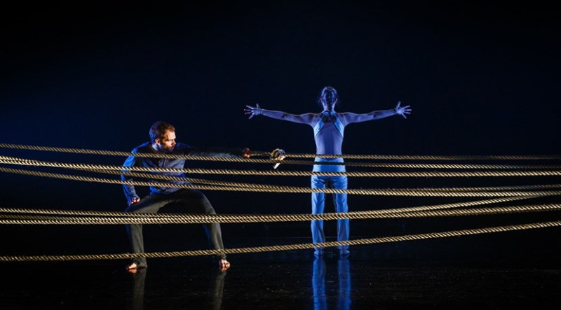 Performers on stage with ropes