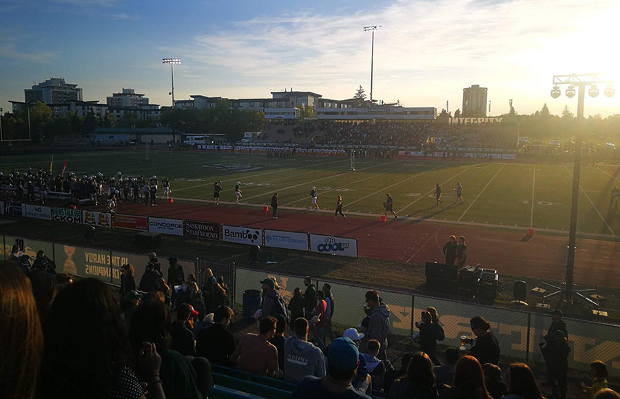 Sun setting over the American Football match