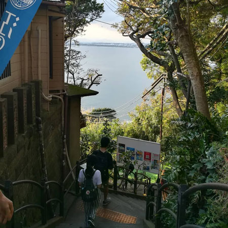 A view down a hill looking out at the sea in Japan