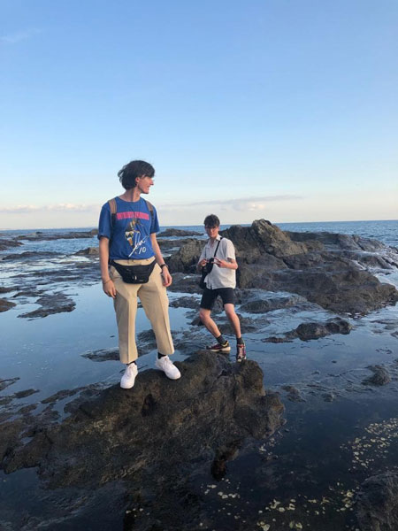 LANS student Harry Croxton on the rocks while the tide is out in Japan