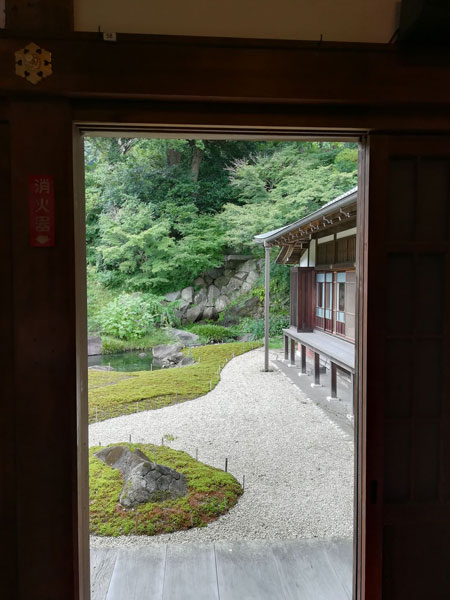 A view through a doorway of a traditional Japanese wood building