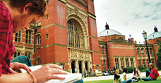 Study Law, photo of a student outside the University of Birmingham Aston Webb building