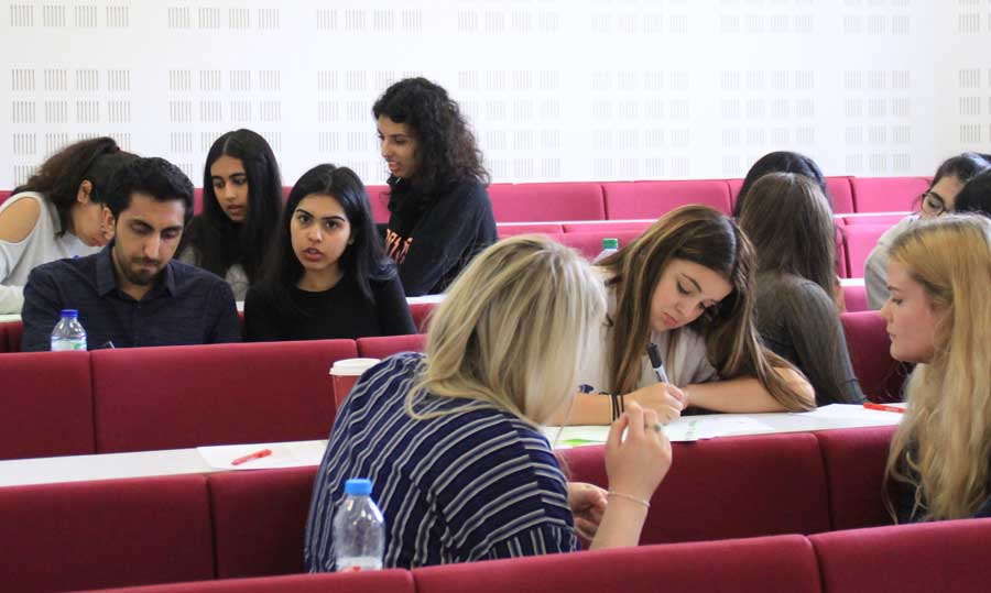 Students working in one of the Birmingham Law School lecture theatres