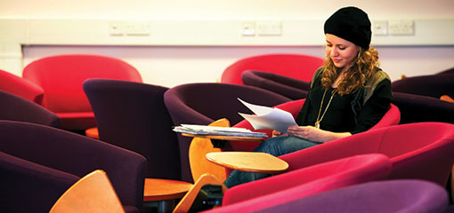 Photo of a female student studying at the University of Birmingham