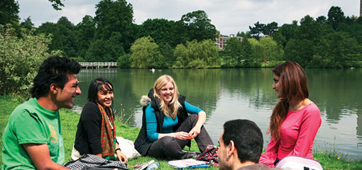 Students socialising by the lake at Birmingham's student accomodation