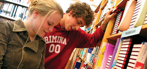 Photograph of students consulting books in the University of Birmingham library