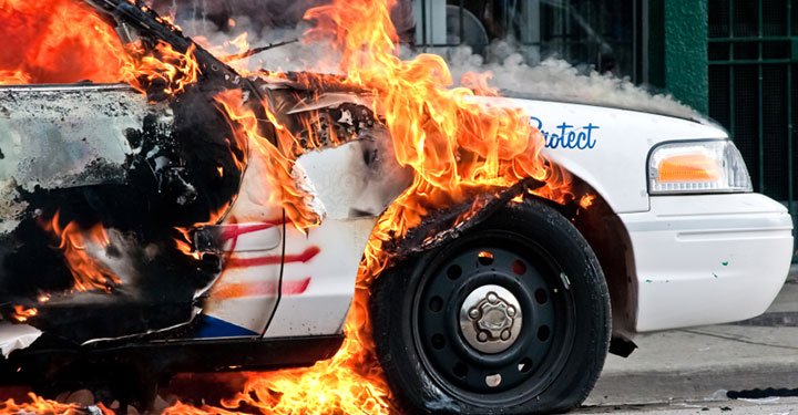 Photo of a burning police car
