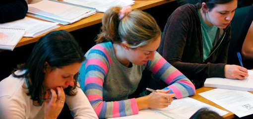 Students making notes during a lecture