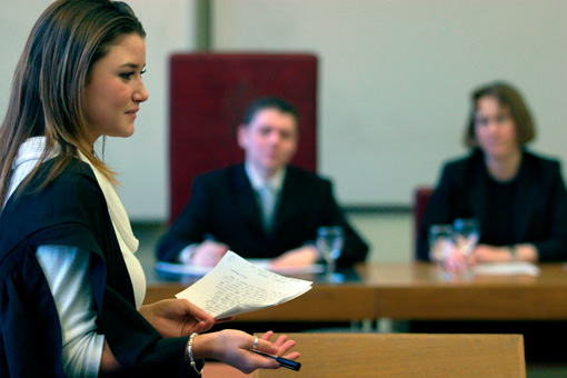 Photograph of students holding a Moot