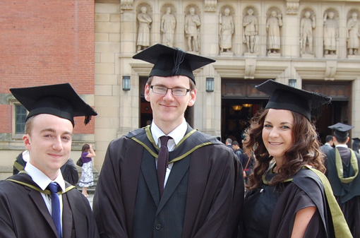 Photo of three Law graduates