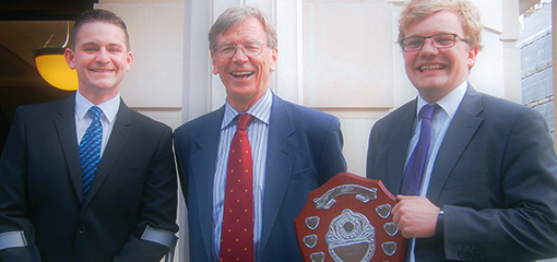Photo of Ben Leb and Richard Murtagh, winners of the 2013 UKELA Moot with Lord Carnwath of Notting Hill