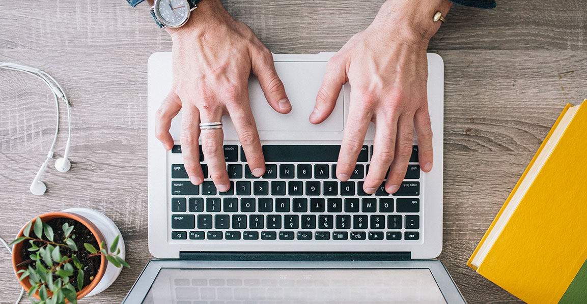 Picture of hands and a laptop