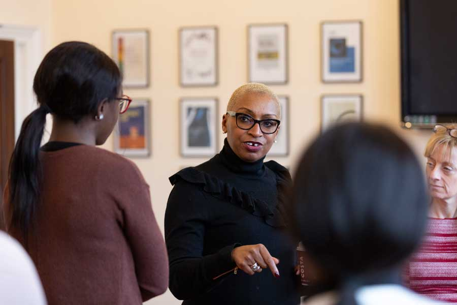 Law alumna Sandie Okoro of the World Bank meeting students at Birmingham