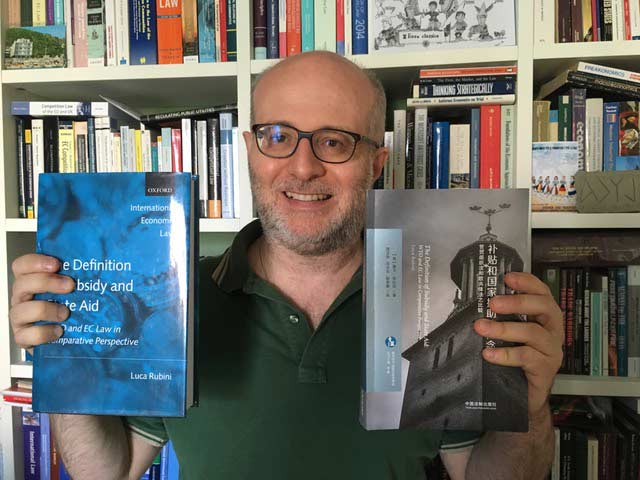 Dr Luca Rubini showed off the covers of the English original and Chinese translation of his book on State Aid