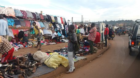 A photograph of a busy and colourful market in Uganda.