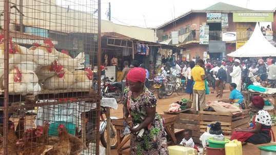 A photograph of a busy road side market in Uganda