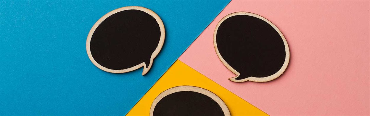Round empty chalk board speech bubbles on colored papers