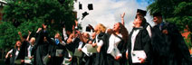 Picture of mortar boards flying on Graduation Day